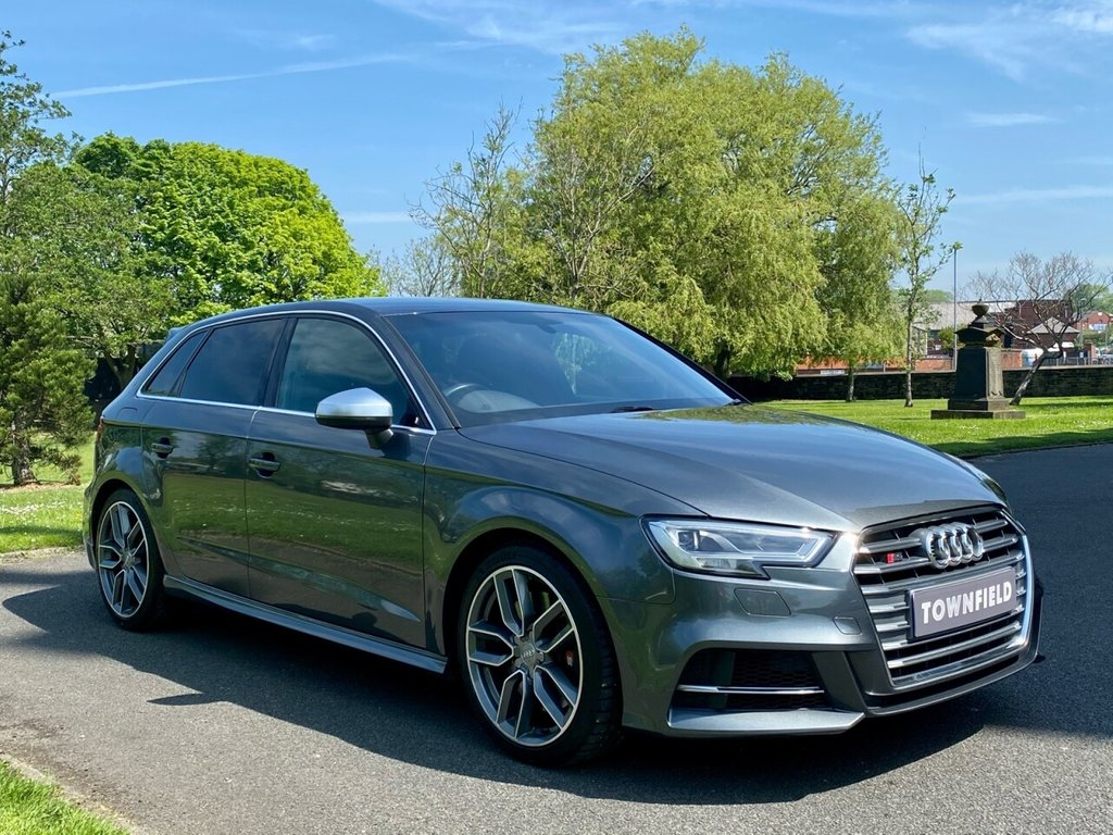 USED 2017 66 AUDI A3 2.0 S3 SPORTBACK QUATTRO 5d 306 BHP A Superb Genuine Low Mileage Example Finished in Metallic Grey with Black Full Leather Heated Sports Seats. 1 Former Keeper from New with a Fantastic Specification to Include: MMI Satellite Navigation + Bluetooth Connectivity + Smartphone Interface + DAB Radio, Un-marked 18 Inch Alloy Wheels, Automatic Bi-Xenon Headlights with Power Wash, Leather Multi Function Sports Steering Wheel with Paddle Shift, On-board Computer