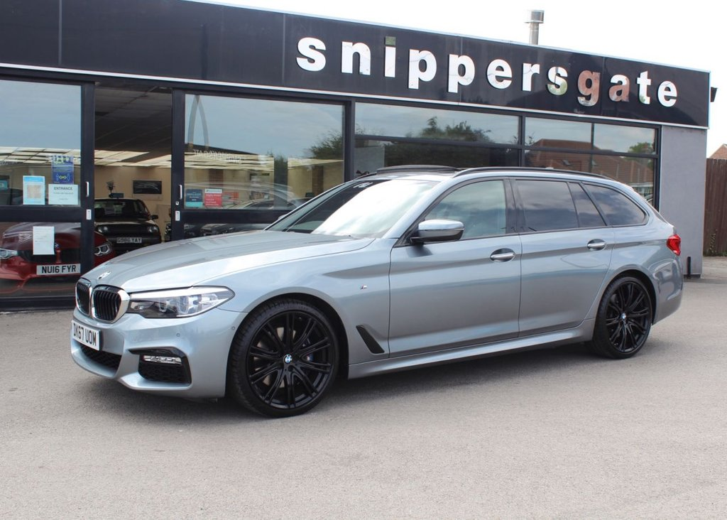 """USED 2017 67 BMW 5 SERIES 3.0 530D XDRIVE M SPORT TOURING 5d 261 BHP Blue Stone Metallic, Full Black Dakota Leather With Exclusive Seam, Panoramic Glass Roof, Sun Protection Glazing, Adaptive Headlights, Reversing Camera, M Sport Brakes, 20"""" V Spoke 759 Alloys, Navigation System Professional, DAB Tuner, Heated Seats, Piano Black Interior Strips, Ambient Interior Lights, Park Distance Control, Tyre Pressure Display, M Sports Package, Sports Seats, M Aerodynamics Package, Anthracite Headlining, 2 Keys and Book Pack, Full Service History - Just Serviced."""